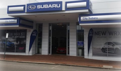 The front view of a Subaru car dealer store